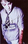 """Richey with 4 Real carved into his arm. The NME discussion as to whether to publish this image was a bonus track on """"Suicide Is Painless""""."""