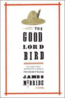 Inside an uneven red rectangular box is a straw hat (top), the book's name, and the author's name, in black font