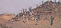 "Muslim archers positioned on a hill during the Battle of Uhud, as depicted in Moustapha Akkad's 1976 film ""<i><a href=""http://reference.findtarget.com/search/Mohammad, Messenger of God (film)/"" class=""wiki"">The Message</a></i>."""