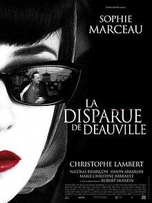 Afiŝo montranta Sophie Marceau portantan malhelajn sunokulvitrojn