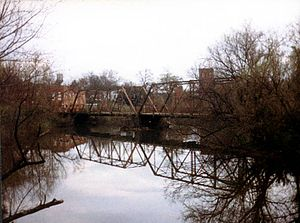 Spartanburg, South Carolina - The old bridge and millpond at Glendale. The mill itself (background) has since burned.