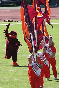 HokieBird runs onto the field with Virginia Tech Cheerleaders