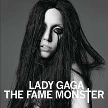 Black-and-white image of Lady Gaga with black, disheveled hair, and black liner around her eyes, dripping down her cheeks.