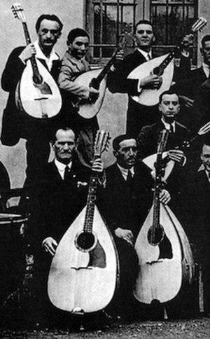 Mandolone - Mandolin Club of Brescia. The front row shows mandolones or mandobasses.