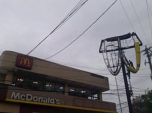 Typhoon Conson (2010) - The upside-down and damaged logo of McDonald's in Antipolo City, after knocking it down by Typhoon Conson in the Philippines.