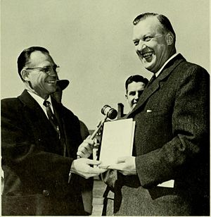 Wilson Homer Elkins - Governor Theodore McKeldin (right) presents Elkins (left) a copy of his book at the opening ceremony of McKeldin Library in 1958.