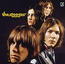 Album cover showing the faces of the four group members