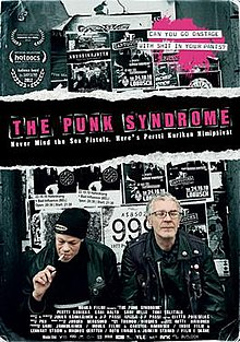 A poster featuring two members of the band sitting in front of black and white gig promotional posters.