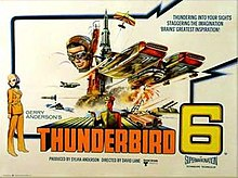 "The words ""Thunderbird 6"" line the bottom edge of a poster which depicts a futuristic aircraft against the backdrop of a tower. The lower hull of this aircraft, resembling an airship of the future, is on fire. A small biplane flies overhead, while from the background the face of a man wearing flying goggles stares in the direction of the viewer."