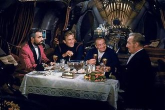 20,000 Leagues Under the Sea (1954 film) - Dinner aboard the Nautilus. From left to right: James Mason, Kirk Douglas, Peter Lorre, and Paul Lukas.