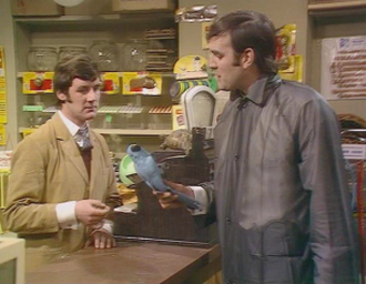 Dead Parrot sketch - Mr Praline (John Cleese) (right) attempts to return his dead Norwegian Blue parrot to the shopkeeper (Michael Palin)