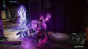 "The player character Delsin Rowe has just used his powers to subdue an enemy, who lays restrained on the floor with light particles that resemble chains wrapped around him. The text prompt in the upper-left hand corner reads ""Enemy subdued""."