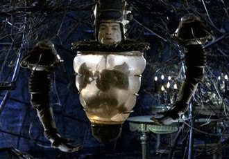Lexx - Mantrid before his transference into a computer, accompanied by two drone arms
