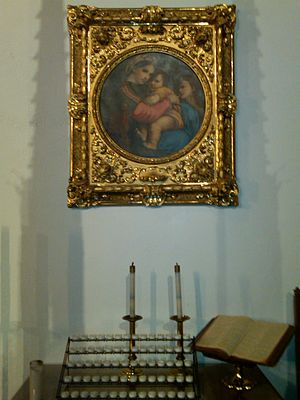 Saints in Methodism - Madonna and Child with a votive candle rack and kneeler in a Methodist church