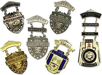 Marksmanship badges (United States) - Examples of the NRA's Winchester/NRA Marksmanship Qualification Badges with shotgun and pistol clasps on the NRA  Distinguished Expert Badge.