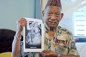 Tul Bahadur Pun - Eighty-four-year-old Pun holding a campaign poster from British supporters for his right to settle in Great Britain.