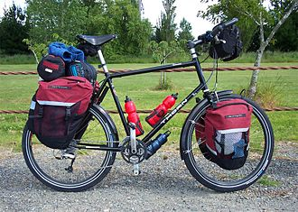 Touring bicycle - A touring bicycle with flat bars and 26-inch wheels