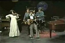 Subject playing for TV in a four-piece band including Rivera, Dylan and Stoner