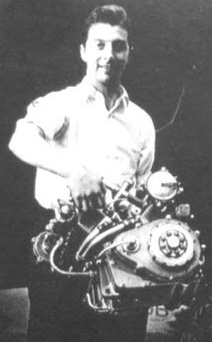 Bill Lomas - Lomas demonstrating the light weight of the Moto Guzzi V8 engine
