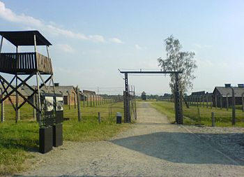 Entrance to Birkenau, 2006. Guard tower, two i...