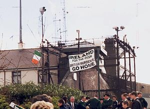 Provisional IRA South Armagh Brigade - Borucki sangar, a British army outpost in Crossmaglen with a republican flag on top during an Ógra Shinn Féin protest some time before its removal in 2000