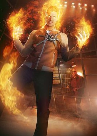 Firestorm (comics) - Robbie Amell as Ronnie Raymond/Firestorm with Victor Garber as Martin Stein in the background.