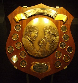 State of Origin series - The first State of Origin shield, depicting Queensland's Wally Lewis and New South Wales' Brett Kenny.