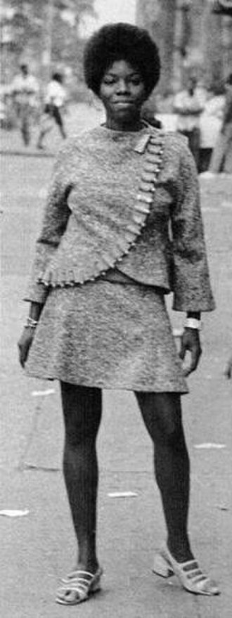 """Wadsworth Jarrell - A model wearing Jae Jarrell's """"Revolutionary Suit"""", which would serve as an inspiration for the painting Revolutionary"""