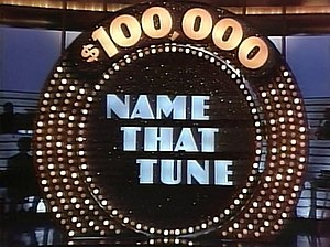 Name That Tune - Onstage logo of The $100,000 Name That Tune from the 1984–85 daily series