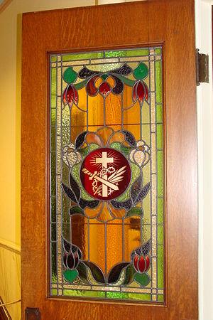 Stain glass door window of St. Ann's Academy