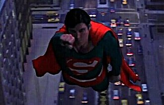 Superman (1978 film) - Actual screen shot for comparison. Suit has greenish hue, for use with blue-screen effects.