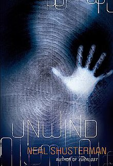 "A vague humanoid form is visible, its left hand extended to the ""screen"" as if waving or motioning for help. The atmosphere is dark and gloomy, similar to that of a womb. A human fingerprint is overlaid on the image. Near the bottom of the image, the title ""Unwind"", along with the author's name, is stenciled in a thin, science fiction-esque font."