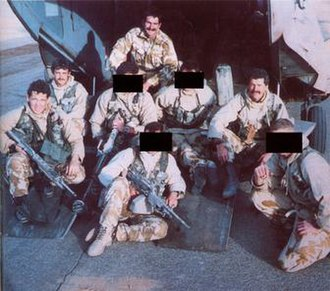 Bravo Two Zero - Bravo Two Zero patrol members. From left to right: Ryan, Consiglio, MacGown (obscured), Lane, Coburn (obscured), Mitchell (obscured), Phillips, Pring (obscured).