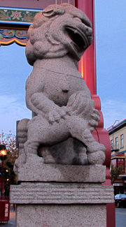 One of the stone lions that guards the gate of Chinatown in Victoria.