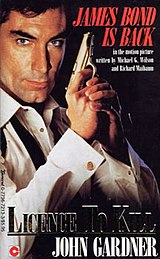 "A book cover showing a man holding a pistol. He is wearing a white dress shirt with untied bow tie. The words ""JAMES BOND IS BACK"" are in the top right hand corner. In the bottom right hand corner are the words ""LICENCE TO KILL JOHN GARDNER""."