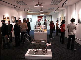 """GLBT Historical Society - The main gallery at the GLBT Historical Society headquarters at 657 Mission St., San Francisco; opening of the """"Polk Street: Lives in Transition"""" exhibition, curated by Joey Plaster (Jan. 16, 2009)."""
