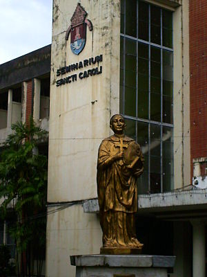 The statue of Saint Charles Borromeo in front of the San Carlos Seminary, Makati City, Philippines.