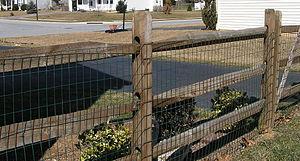 Split-rail fence - A mortised split-rail fence in suburban America (built 1999).