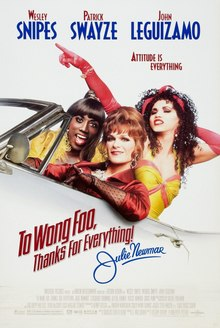 3 drag queens ride in a car.