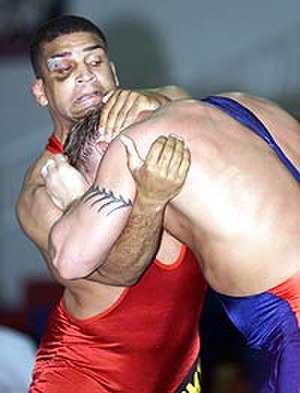 Underhook - The wrestler in red has an underhook, while the blue wrestler attempts to reverse