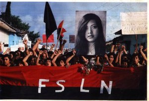 Arlen Siu - A group of Nicaraguans holding and marching with a picture of Arlen Siu and the FSLN flag in Jinotepe 3 years after her death.