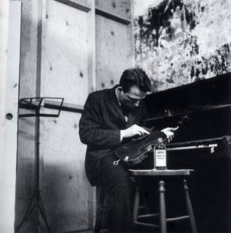 Postmodern art - Solo For Violin • Polishing as performed by George Brecht, New York, 1964. Photo by G Maciunas