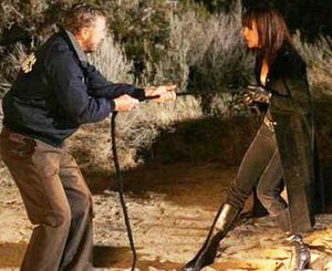 Lady Heather - Gil Grissom (William Petersen), struggling with Lady Heather (Melinda Clarke) during her third appearance on CSI