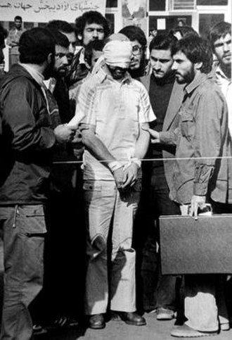 Iran hostage crisis - Barry Rosen, the embassy's press attaché, was among the hostages. The man on the right holding the briefcase is alleged by some former hostages to be future President Mahmoud Ahmadinejad, although he, Iran's government, and the CIA deny this.