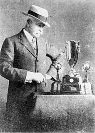 Macpherson Robertson - Sir Macpherson Robertson with the winners trophy for the MacRobertson Air Race