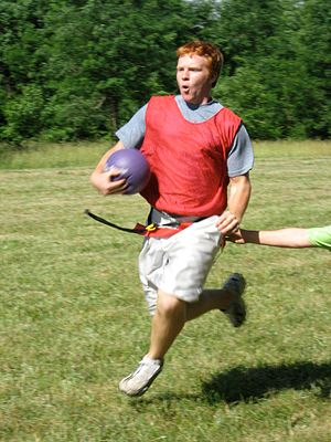 "Capture the flag - An ECyD member playing a variation of capture the flag, in which the ""flag"" is a softball, at Camp River Ridge in Indiana"