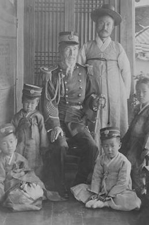 Yun Chi-ho - Yun Chi-ho is standing at the rear. His father, Yun Ung-nyeol is seated, wearing the western uniform of the Korean Empire. This photograph captures the General with his family c. 1910.