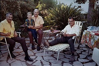 Saul Elkins - Family photo of Saul with his two brothers. Left to right, the adults are: Leon Elkins, Saul Elkins and Michael Elkins. Seated on Saul's knee is his great nephew, Leon's grandson.