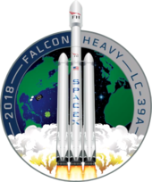 Artistic depiction of a Falcon heavy rocket launching from the Earth, represented in the background by a circular patch.