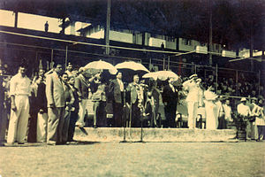 1950 National Games of India - 1950 Indian National Games: Governor of Bombay Raja Maharaja Singh (in garland under umbrella); Bombay Olympic Committee Chairman Anthony de Mello (to his immediate left in picture), and others